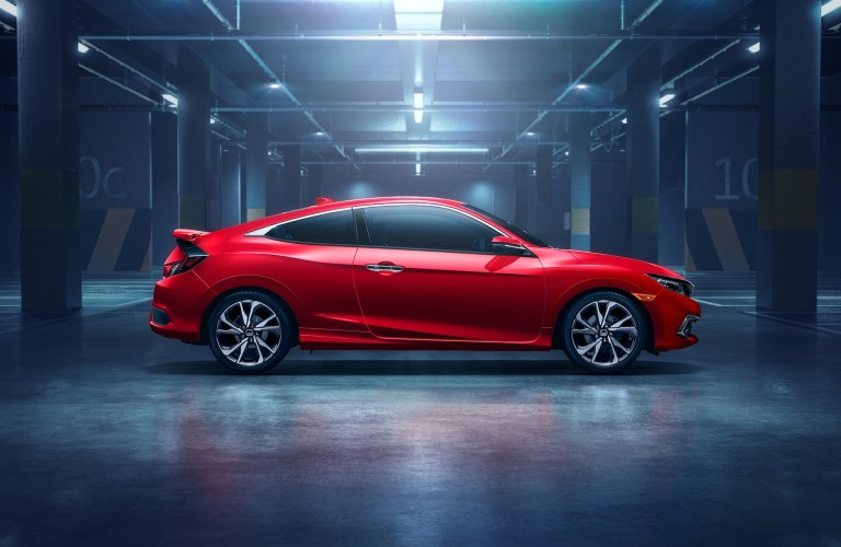 Passenger angle of a red 2020 Honda Civic Coupe