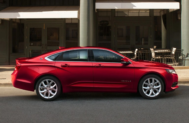 Passenger angle of a red 2020 Chevrolet Impala
