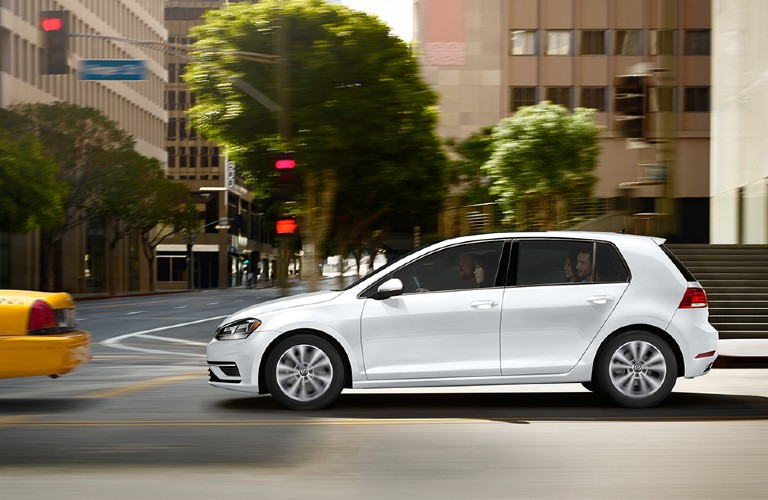 Driver angle of a white 2020 Volkswagen Golf driving on a road