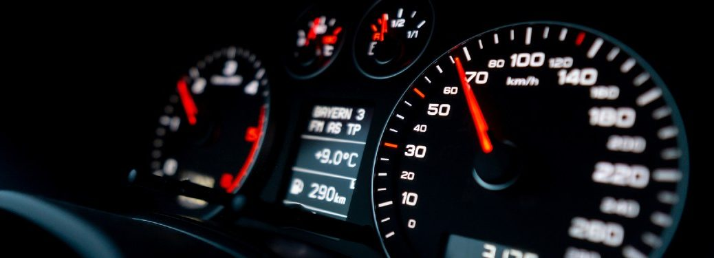 Close up of a speedometer inside a vehicle