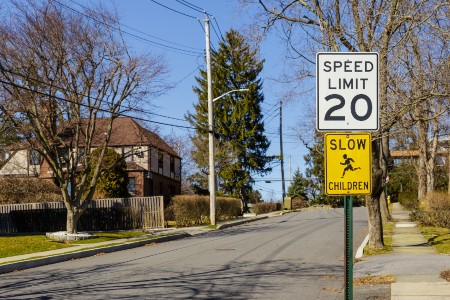"Speed limit sign with a ""slow for children"" sign below it"