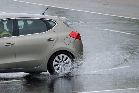Rear driver angle of a car driving in rain