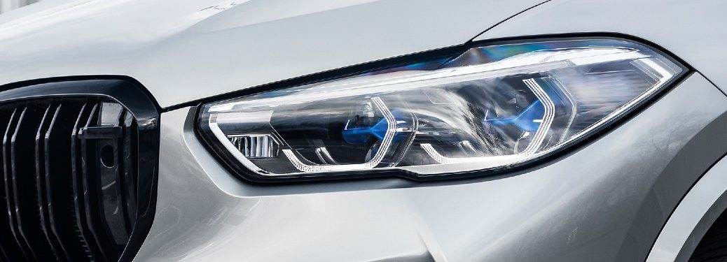 Close up of a headlight on a silver car