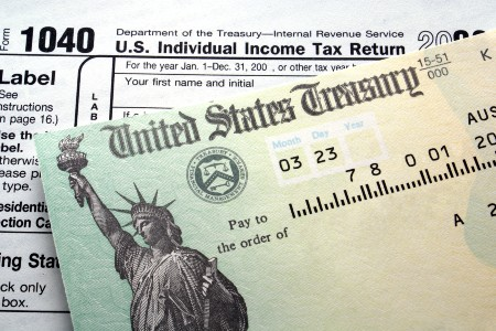 Tax return check on top of a 1040 form