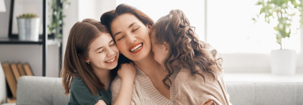 Happy mom with her two daughters