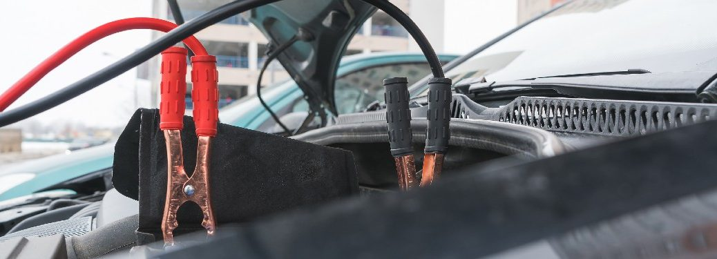Jumper cables connected to a vehicle