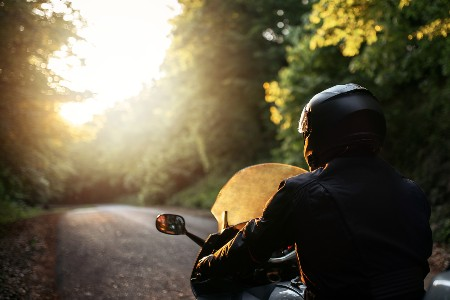 Motorcyclist riding on a sunny day