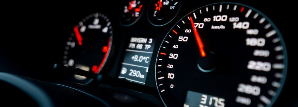 Close up of a speedometer in a car