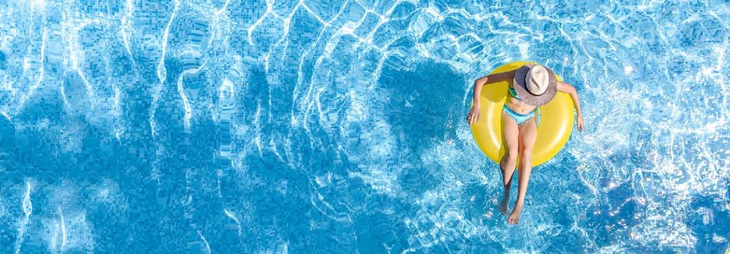 Girl floating in an inflatable tube in a swimming pool