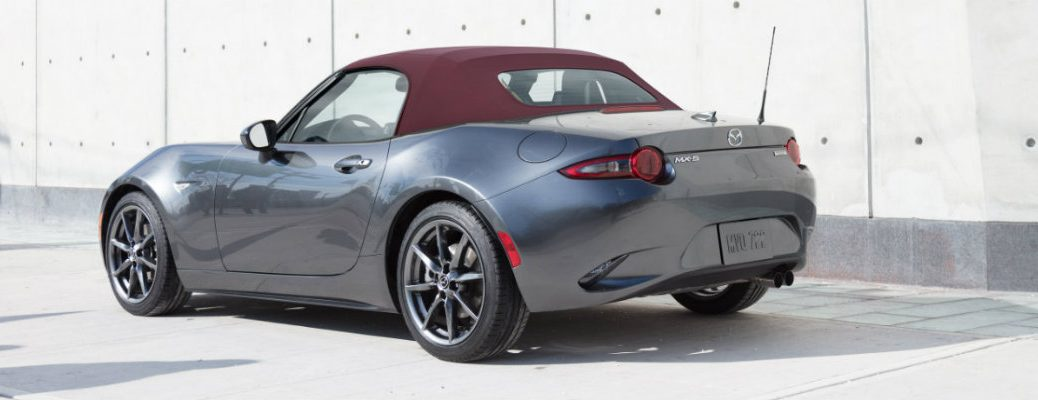 View of silver 2018 Mazda MX-5 Miata parked in a lighted area during the day