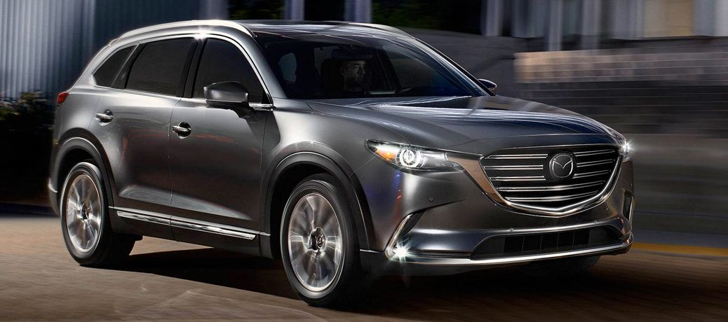 Exterior view of a silver 2019 Mazda CX-5 parked outside a home