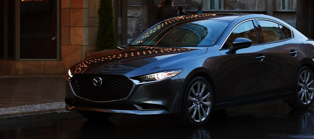 Exterior view of a gray 2019 Mazda3 parked on a city street