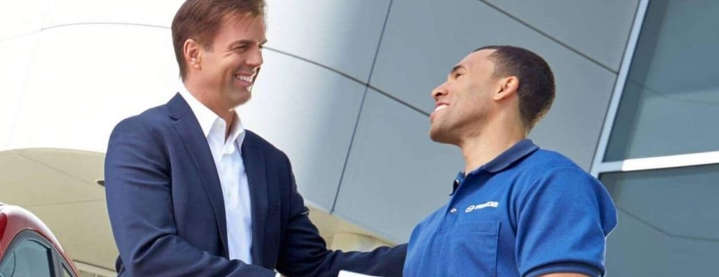 Customer shaking the hand of a Mazda Certified Technician