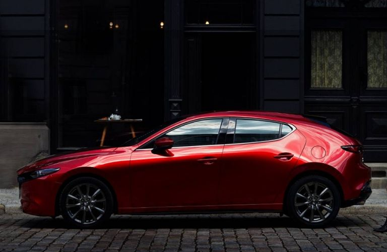 Exterior view of a red 2019 Mazda3 Hatchback