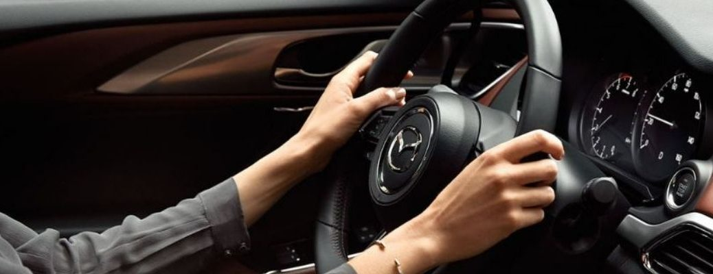 Closeup view of the steering wheel in a Mazda vehicle