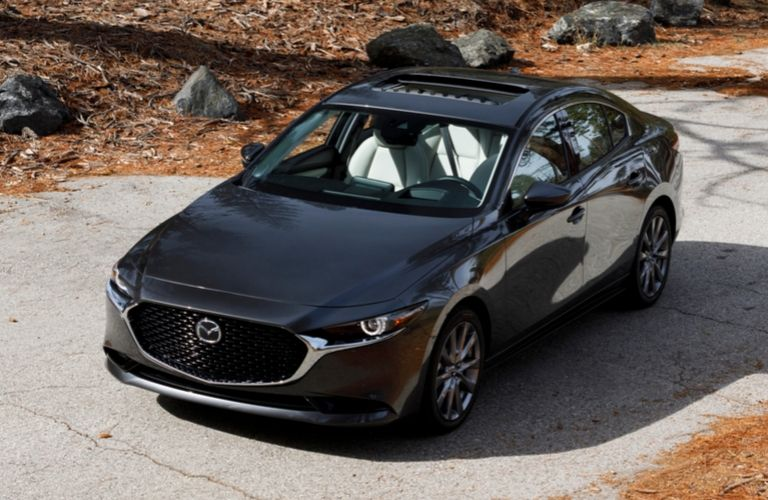 Exterior view of the front of a black 2020 Mazda3 Sedan