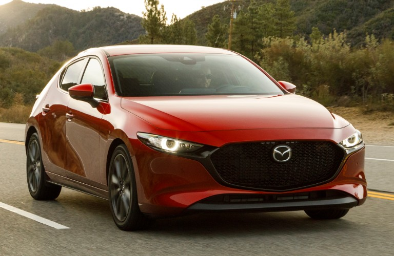 Exterior view of the front of a red 2020 Mazda3 Hatchback