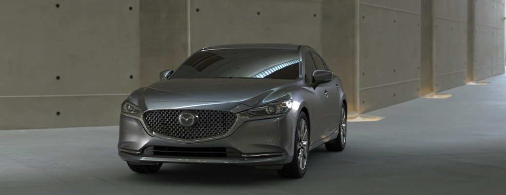 2020 Mazda6 grey paint exterior shot from front parked on pavement under a bridge