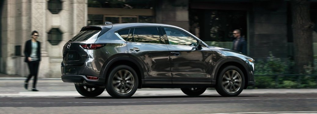 A 2019 Mazda CX-5 Signature Diesel driving down a road