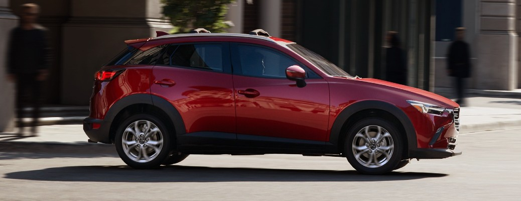 The side view of a red 2021 Mazda CX-3.