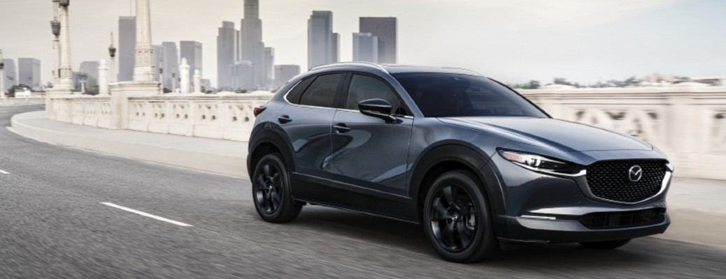 The front and side view of a gray 2021 Mazda CX-30.