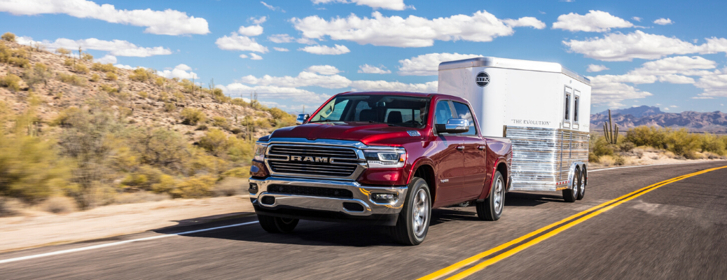 Red 2020 Ram 1500 Laramie pulling a trailer
