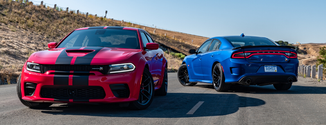 Front view of 2020 Dodge Charger Scat Pack Widebody in TorRed and rear view of 2020 Dodge Charger SRT Hellcat Widebody in Indigo Blue