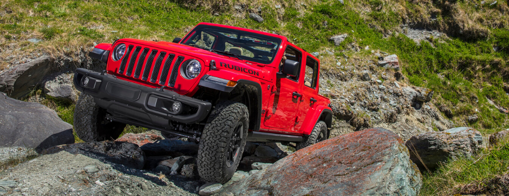 Front view of red 2020 Jeep Wrangler Rubicon rock crawling