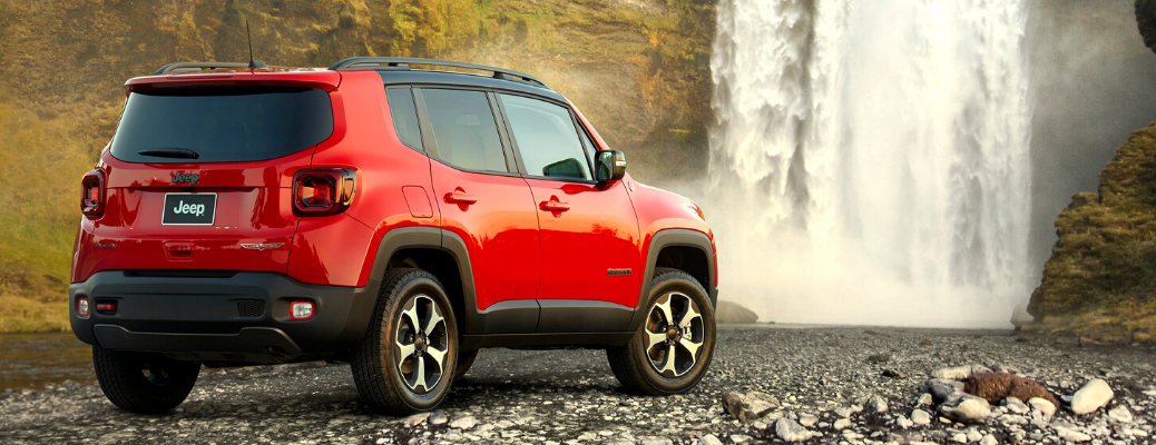Rear view of Colorado Red 2020 Jeep Renegade Trailhawk in front of waterfall