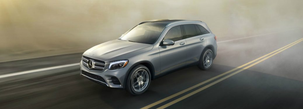 mercedes-benz glc suv driving on road in the fog