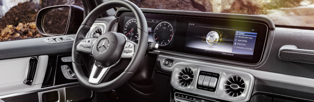 interior view of the 2019 Mercedes-Benz G-Class with touchscreen display and steering wheel on dashboard