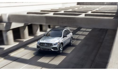 2020 Mercedes-Benz GLC SUV driving under concrete overhang grey paint and shadows on road
