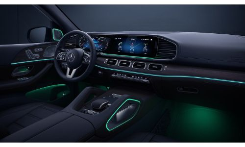 2020 Mercedes-Benz GLE SUV interior shot showing ambient lighting green and large touchscreen display and steering wheel