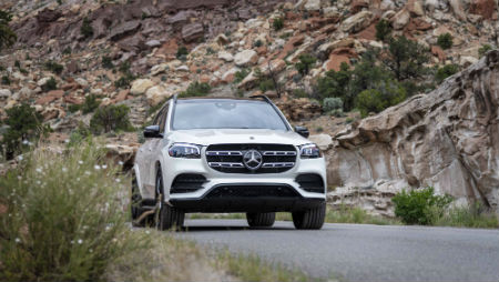 2020 MB GLS exterior front fascia passenger side on road in front of rocky cliff