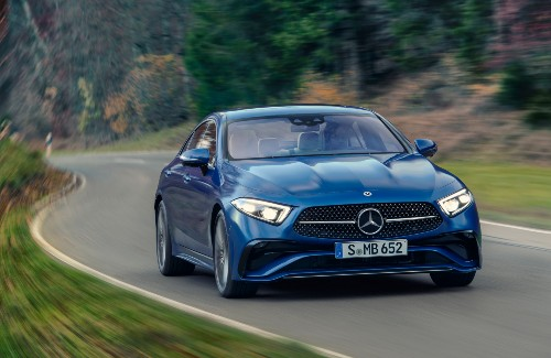 2022 Mercedes-Benz CLS blue exterior front fascia driving on curvy highway