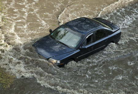 car driving and getting stuck on flooded road