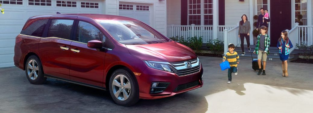 2018 honda odyssey parked in driveway with family