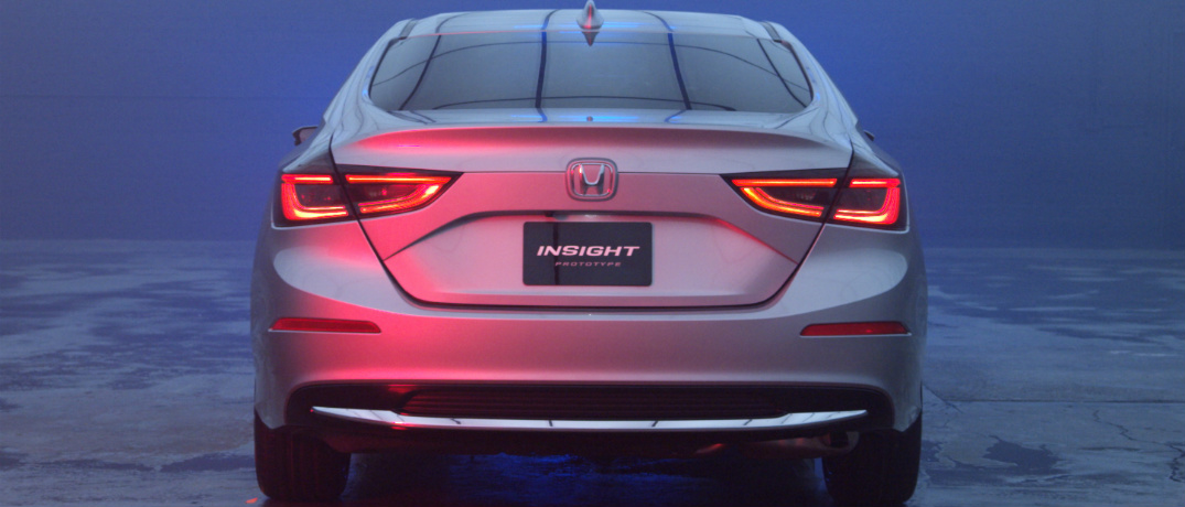 close up view of rear end of Honda Insight under blue and red lighting