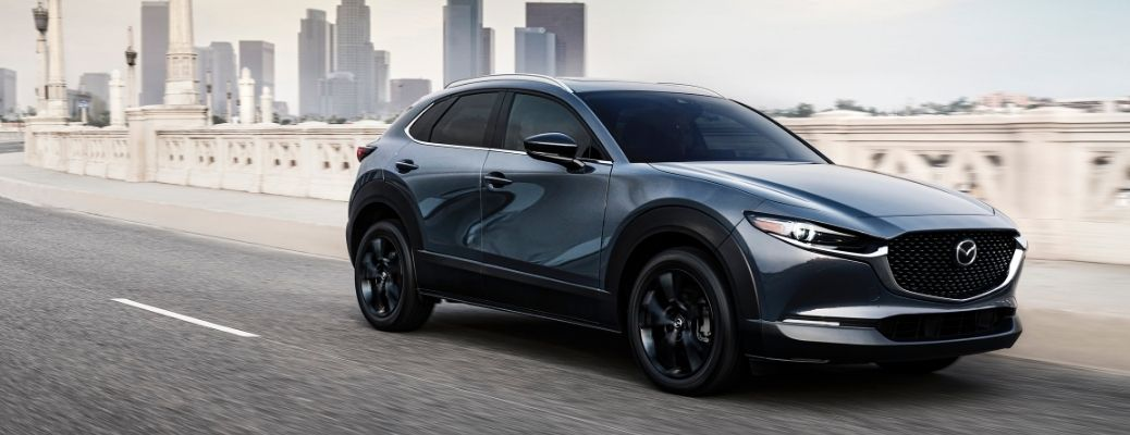 2021 Mazda CX-30 2.5 Turbo driving away from city