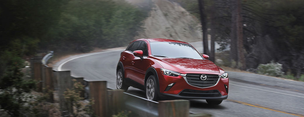 Red 2021 Mazda CX-3 driving