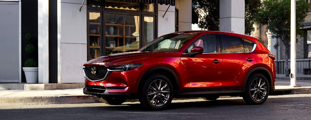 Red 2021 Mazda CX-5 parked on street