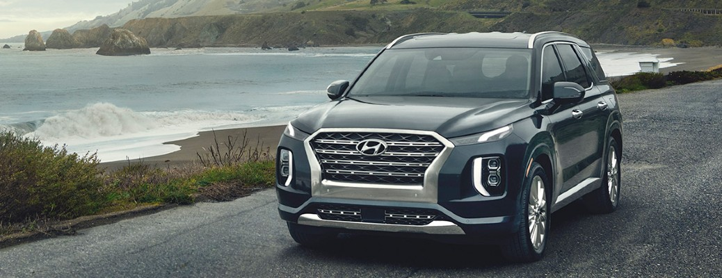 2020 Hyundai Palisade front driver side on road next to ocean