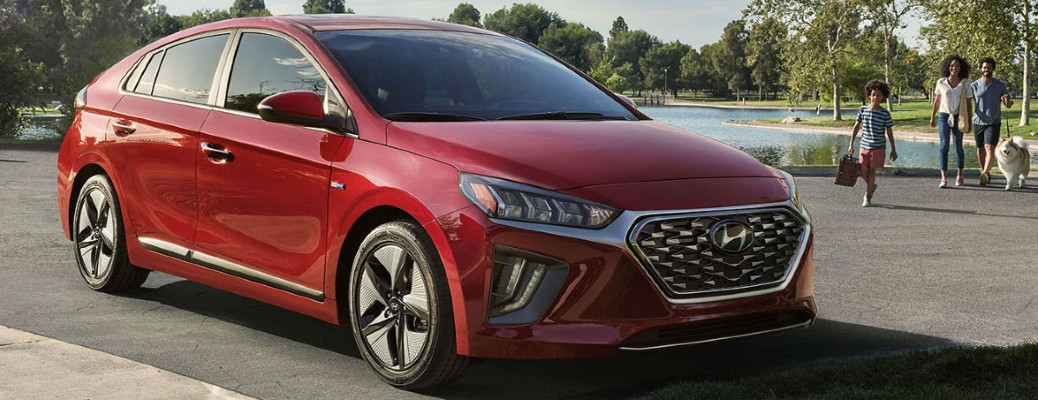 2020 Hyundai Ioniq Hybrid red exterior parked family walking with dog