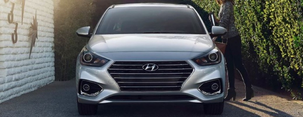 2020 Hyundai Accent silver exterior front parked person getting in to driver seat