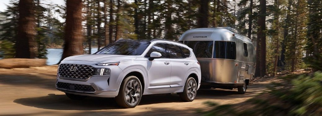 2021 Santa Fe towing camper on wooded road