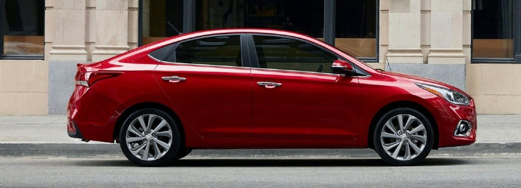 2021 Hyundai Accent red exterior passenger side parked on side of street