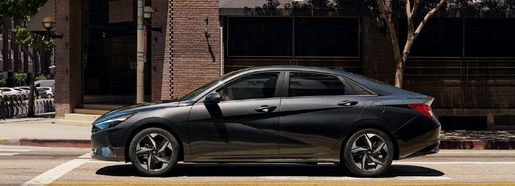 2021 Hyundai Elantra black exterior driver side stopped at intersection in city