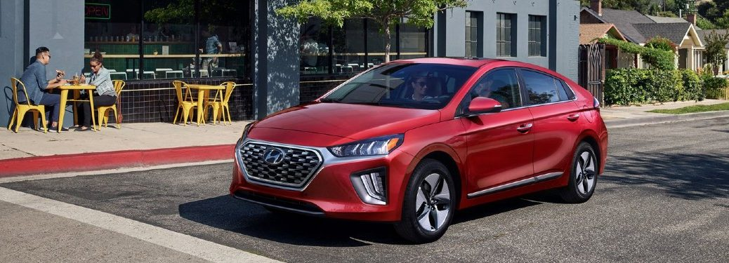 2021 Ioniq hybrid red exterior driving in city