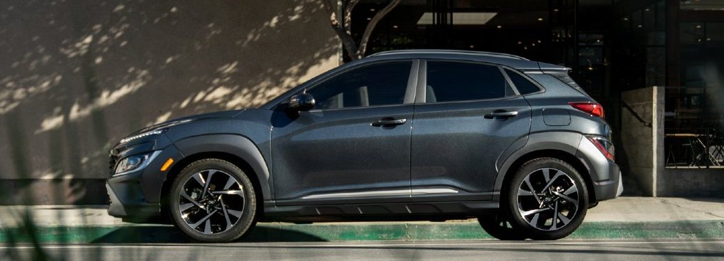 grey 2022 Hyundai Kona driver side parked on side of road