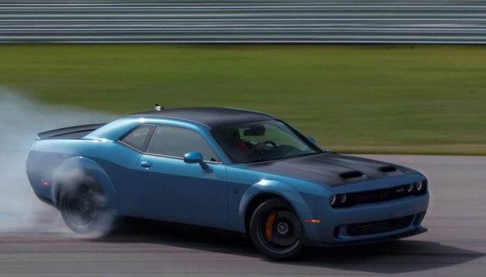 2020 Dodge Challenger driving down a closed track